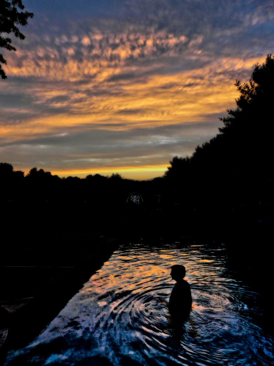The artist's muse - the Hobbitt - in the pool at sunset #1 - The artist's muse at sunset -- DMC-FZ18 -  Panasonic DMC-FZ18 - Tony Karp, design, art, photography, techno-impressionist, techno-impressionism, aerial photography , drone , drones , dji , mavic pro , video , 3D printing - Books -